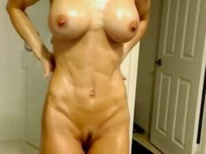 Busty Fit MILF Oils Up In Bathroom
